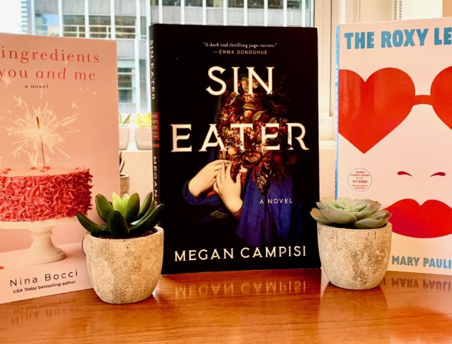 Three new books on a table