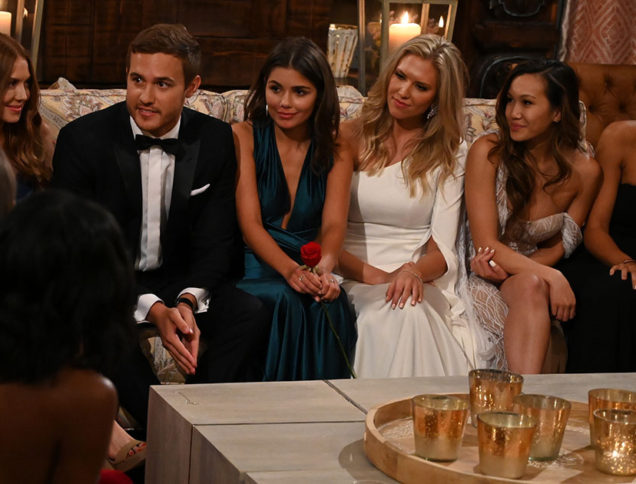 Bachelor Contestants sit on couch