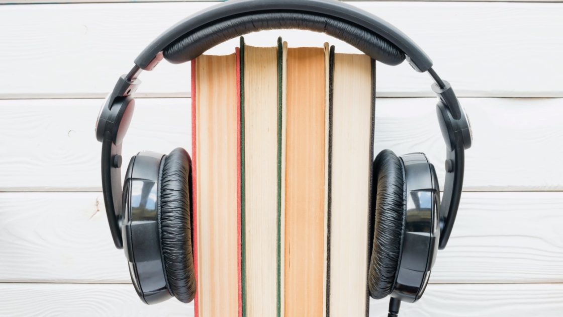 Headphones wrapped around books