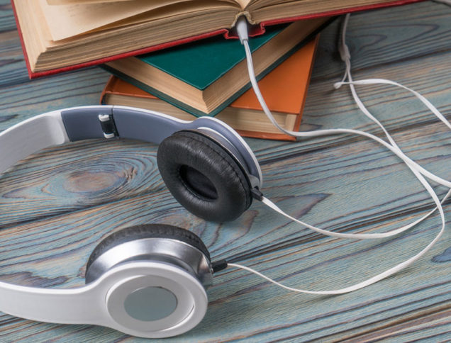 Headphones plugged into books