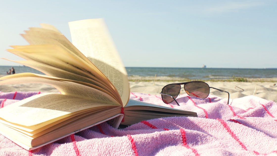 Book on beach towel
