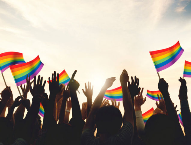 LGBTQ+ pride flags waving in celebration