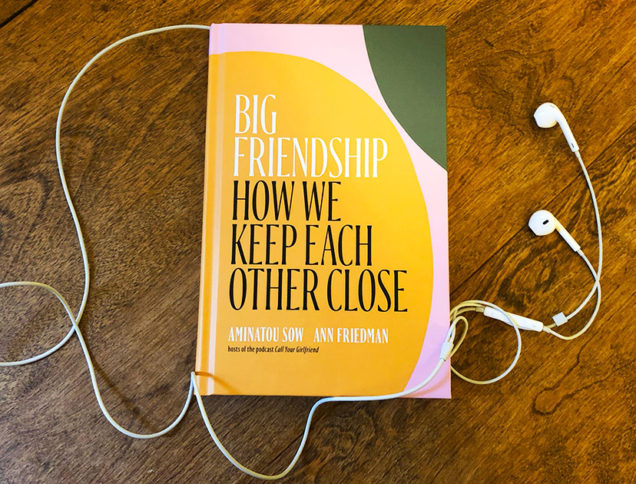 Big Friendship book on table with earbuds