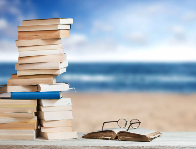 Stack of books on the beach