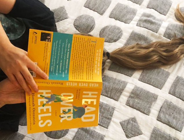 Reading Head Over Heels on a bed