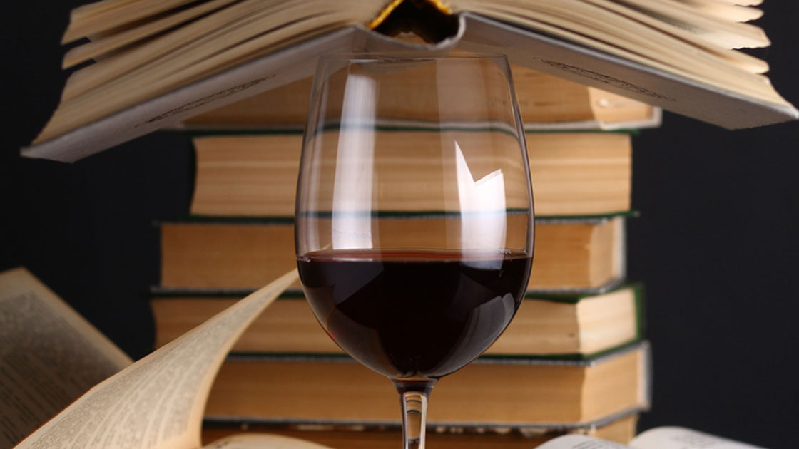 Red Wine with a stack of books
