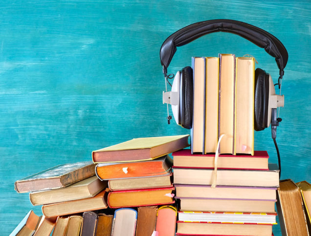 Headphones on a pile of books