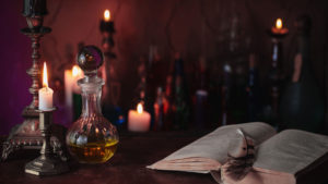 Candles and potions in a dark room