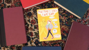 The Times I Knew I Was Gay book surrounded by books